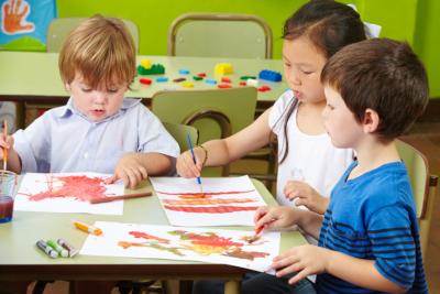 Three children painting